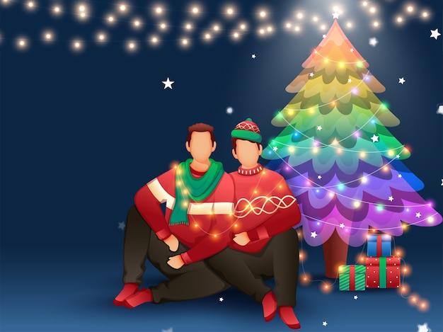 Twee anonieme man zit met decoratieve kerstboom