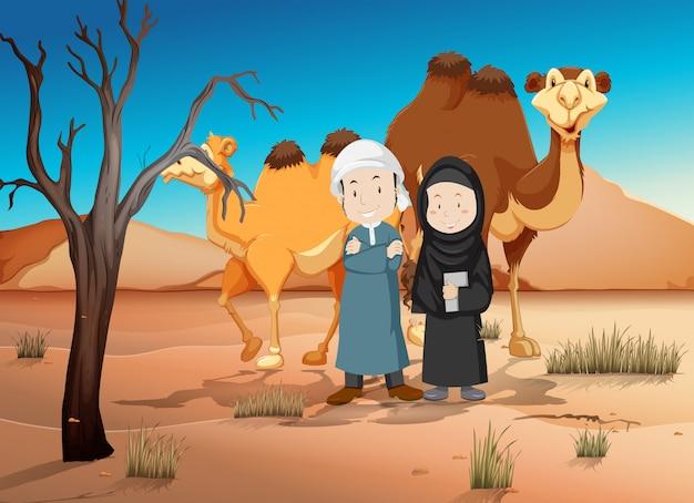 Twee arabische mensen en kamelen in de woestijn