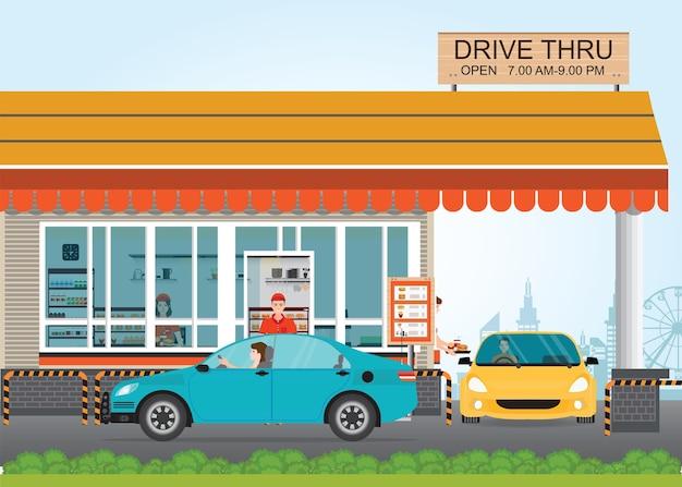 Twee auto's krijgen eten in een drive thru restaurant.