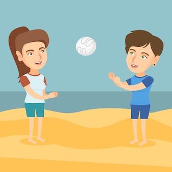 Twee blanke vrouwen spelen beachvolleybal.