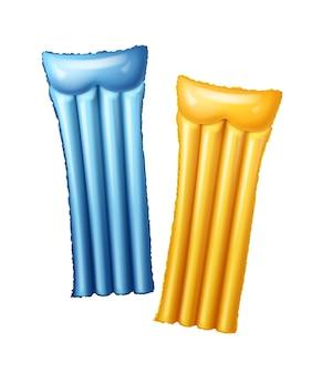 Twee blauwe en gele luchtmatrassen