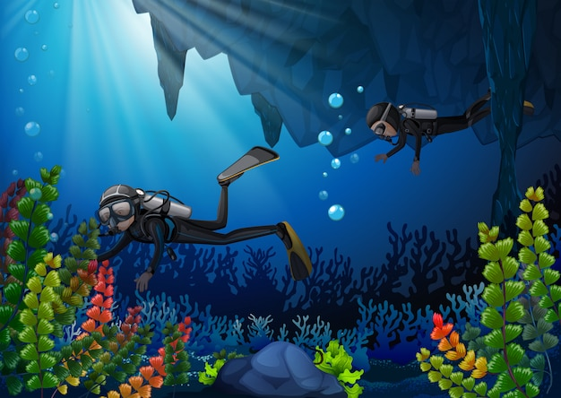 Twee duikers onder water