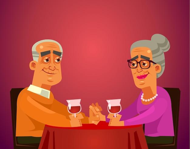 Twee gelukkige lachende oude mensen koppelen oma en opa karakters zittend op tafel restaurant