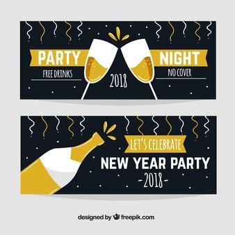 Twee hand getrokken de banners van de nieuw jaarpartij in zwarte met champagne