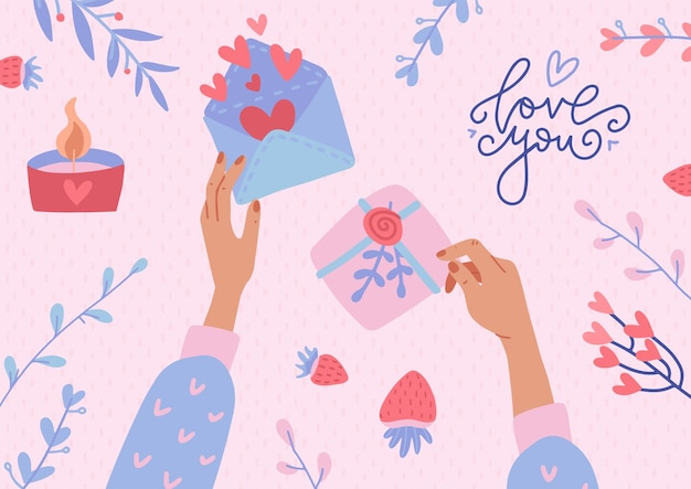 Twee handen met de open envelop met harten en versierde geschenkdoos