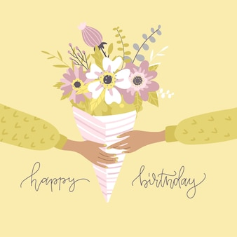 Twee handen met een boeket bloemen in papieren verpakkingstakken van eucalyptushydrangea lelie in pastelkleuren