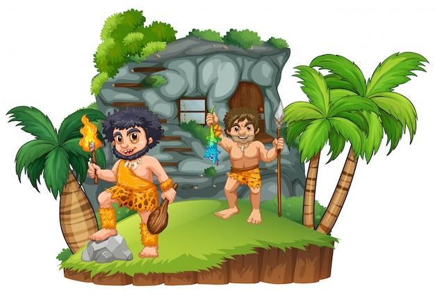 Twee holbewoners bij het rotsachtige huis