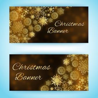 Twee horizontale kerstbanners met sneeuwvlokken van verschillende grootte en vorm