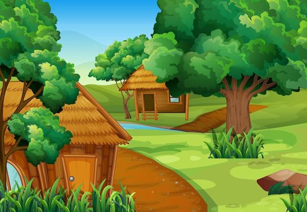 Twee houten hutten in het bos