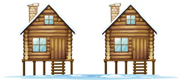 Twee houten hutten op het veld