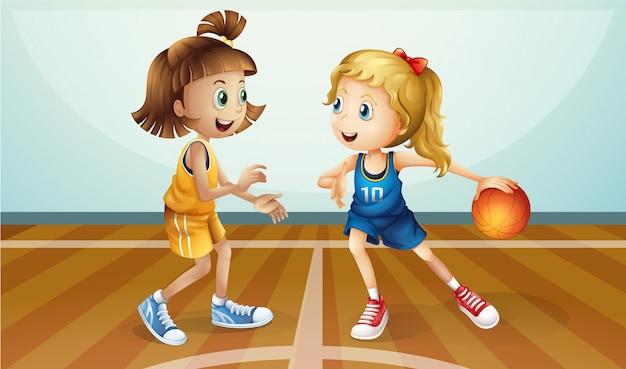 Twee jonge dames spelen basketbal