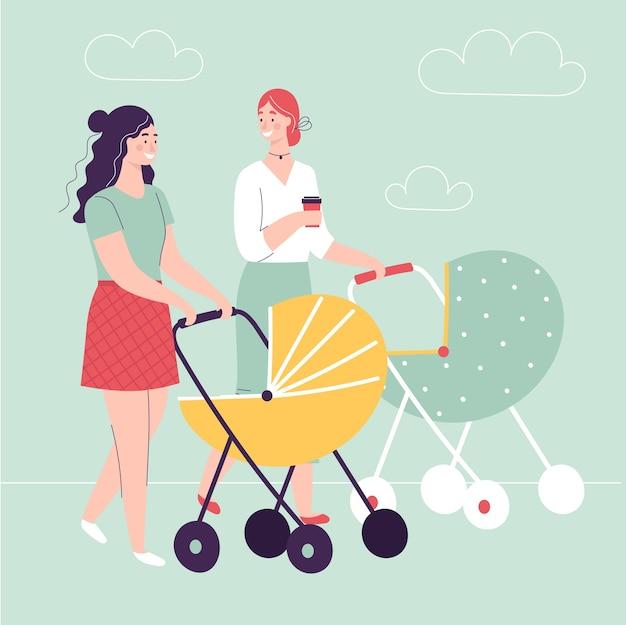 Twee jonge vrouwen die met kinderwagens lopen
