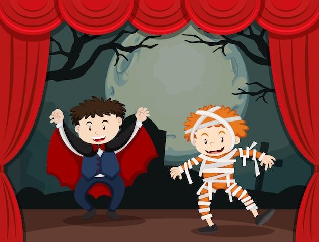 Twee jongens in halloween-kostuum op stadium
