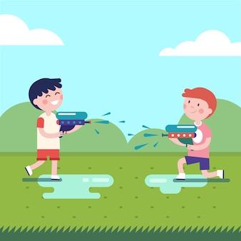 Twee jongens spelen waterpistolen oorlogen