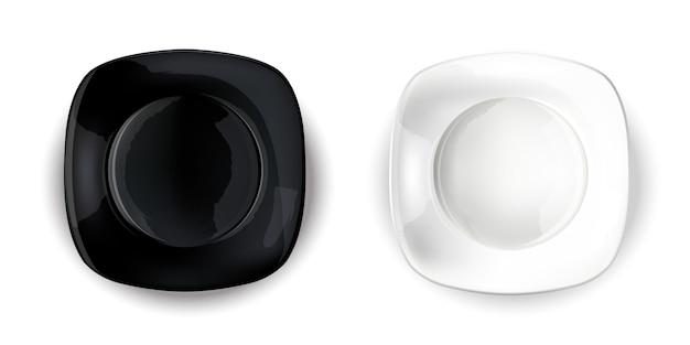 Twee lege vierkante platen - zwart en wit.