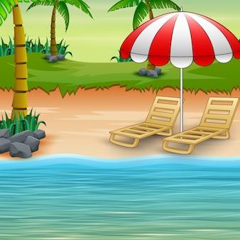 Twee ligstoelen en parasols aan zee