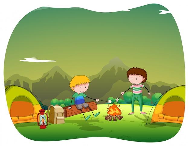 Twee mannen die in het veld kamperen