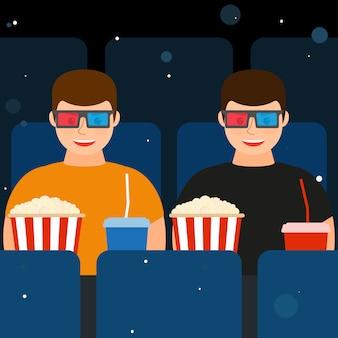 Twee mannen in de bioscoop in 3d-bril met popcorn en drankjes.