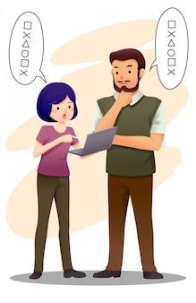 Twee mensen bespreken het werk samen