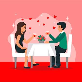 Twee mensen zitten aan tafel met bloemen in restaurant te vieren.