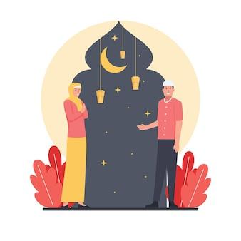 Twee moslimman en vrouwengroet voor de komst van de ramadan.