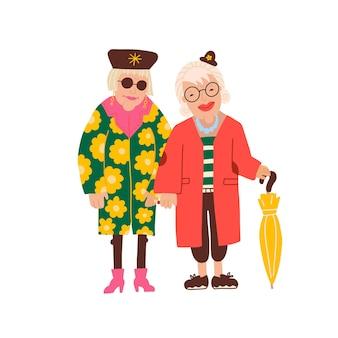 Twee oude dames die behoorlijk modieuze kleding dragen, leuke grappige oudere vrouwelijke karakters in heldere jassen acteren...