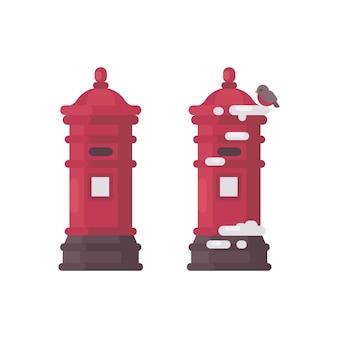 Twee rode vintage brievenbussen met sneeuw. oude brievenbussen wachten op brieven aan de kerstman