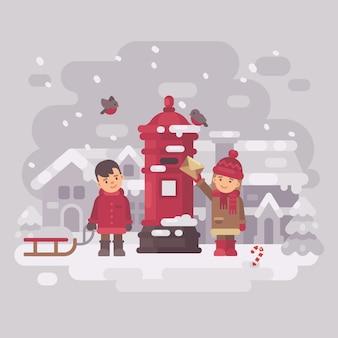 Twee schattige kinderen die een brief naar de kerstman sturen.