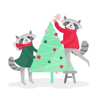 Twee schattige wasberen versieren de kerstboom