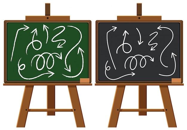 Twee schoolborden met doodlespijlen