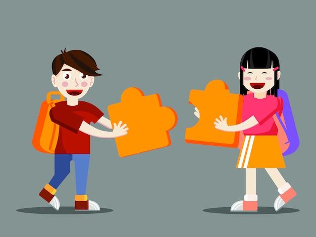 Twee studenten die grote puzzelstukken verbinden
