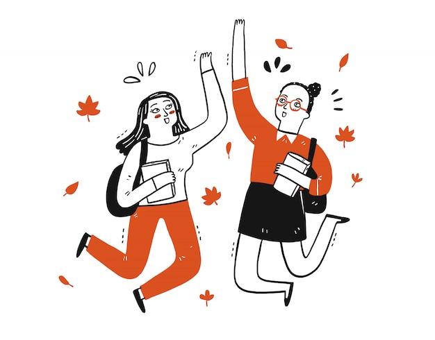 Twee studenten doen high five alsof ze ergens blij mee zijn.