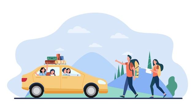 Twee toeristen die auto op weg vangen