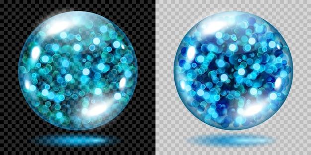 Twee transparante bollen gevuld met lichtblauwe gloeiende glitters met bokeh-effect