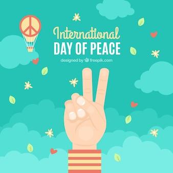 Twee vingers, confetti en vredesymbol