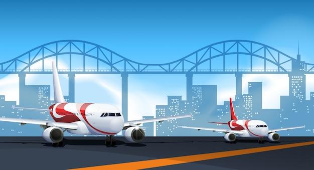 Twee vliegtuigen die op baan parkeren