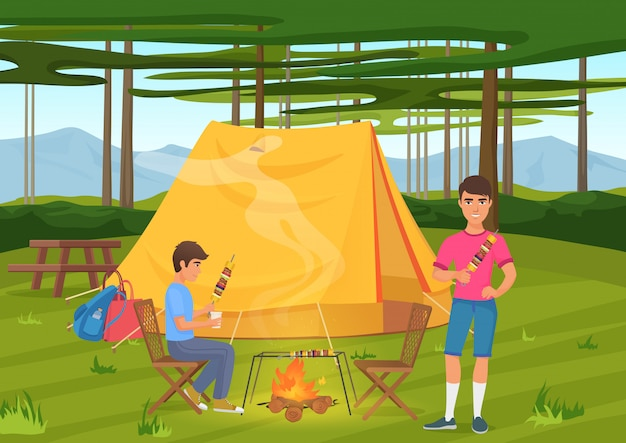 Twee vrienden die bbq barbecue koken en dichtbij het kamperen tent zitten.