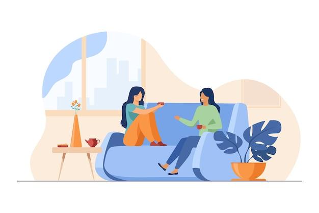 Twee vriendinnen ontmoeten elkaar en chatten thuis