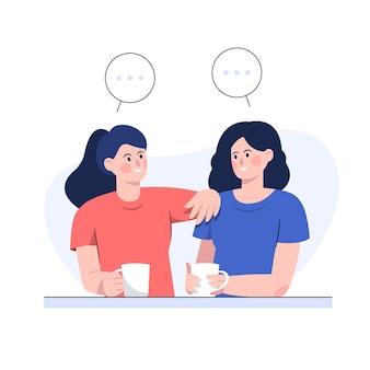 Twee vriendinnen praten terwijl ze koffie drinken