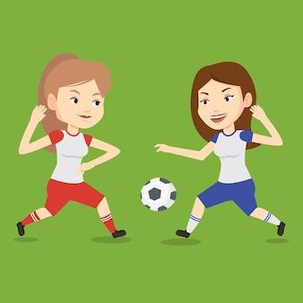Twee vrouwelijke voetballers die voor bal vechten.