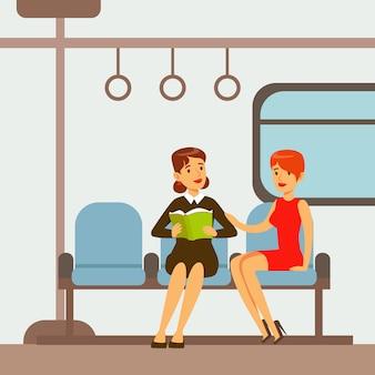 Twee vrouwen die in metro treinauto zitten