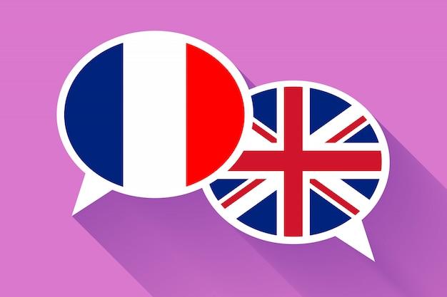 Twee witte tekstballonnen met vlaggen van frankrijk en groot-brittannië