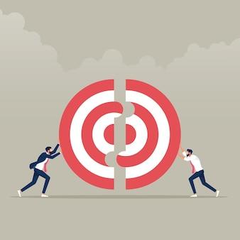 Twee zakenlieden die een groot doel samen duwen bedrijfsgroepswerkconcept