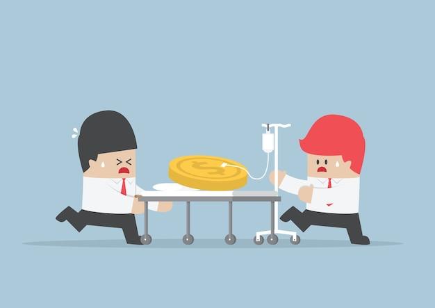 Twee zakenlieden met dollarsmuntstuk op het ziekenhuisbed