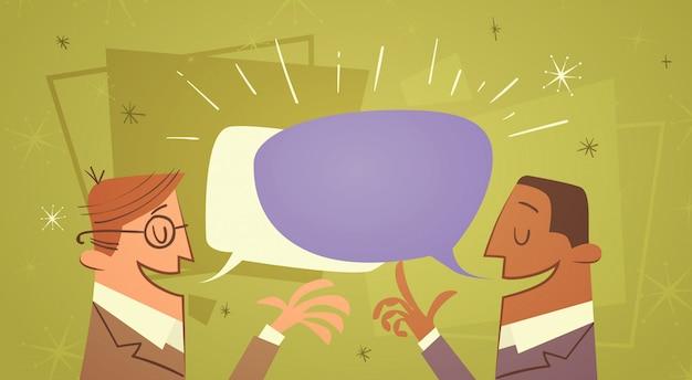 Twee zakenman praten chat box bubble mededeling business man