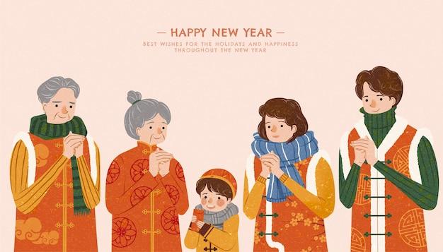Uitgebreide familie geeft nieuwjaarsgroet in klederdracht met vuist- en palmsaluut