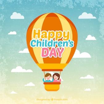 Uitstekende achtergrond met een hete luchtballon en twee kinderen