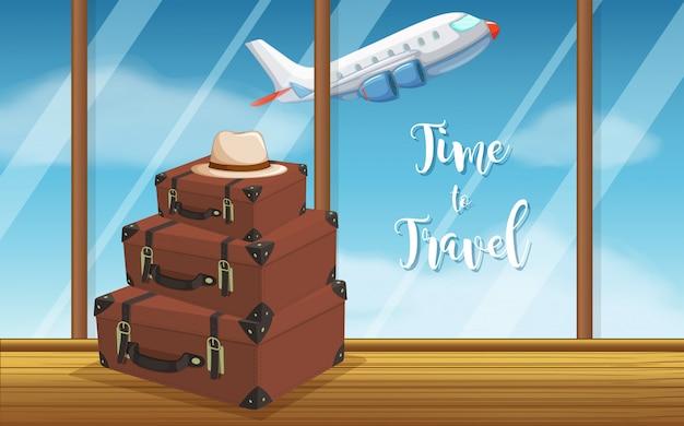 Uitstekende bagage bij luchthavenachtergrond