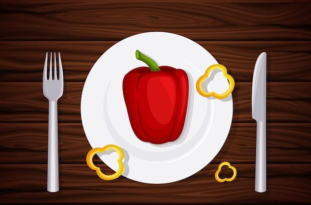 Uitstekende kwaliteit houtstructuur, tafel, blad, paprika op een bord, plakjes peper.
