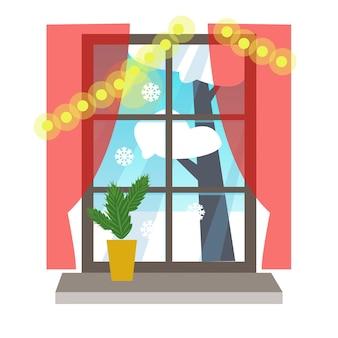 Uitzicht door het raam naar de straat winterlandschap versierd met kerstboom
